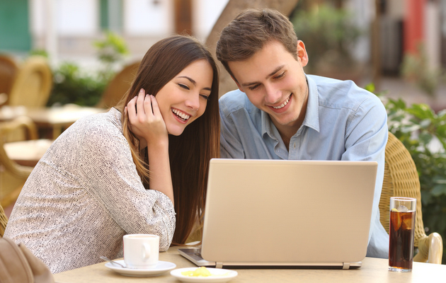 Young couple at a laptop enjoying McStreamy.com.